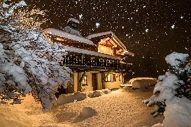 Chalet it night in snow.jpg