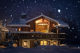 Chalet it night in snow front.jpg