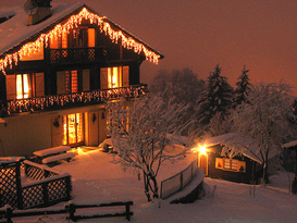 The Chalet all lit up at night in the fresh snow