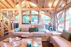 Chalet Granit living room + kitchen with large windows opening on mountains, glaciers and Mont Blanc