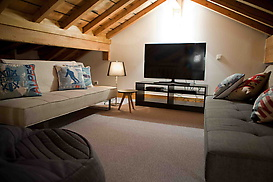 Loft den with Smart TV and games console