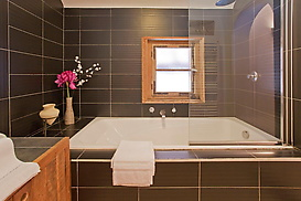 Bathroom with shower and deep fill bath